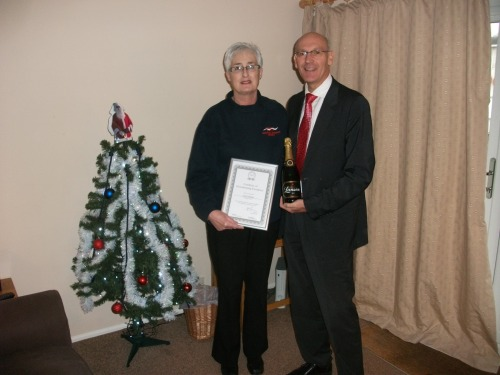 Carole Young, being presented by Tim Tyler of Camplings award for 2012 House Keeper of the Year.